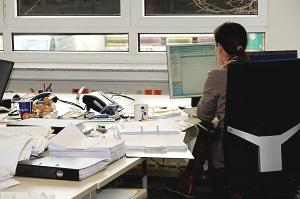 Cluttered L-Shape Desk